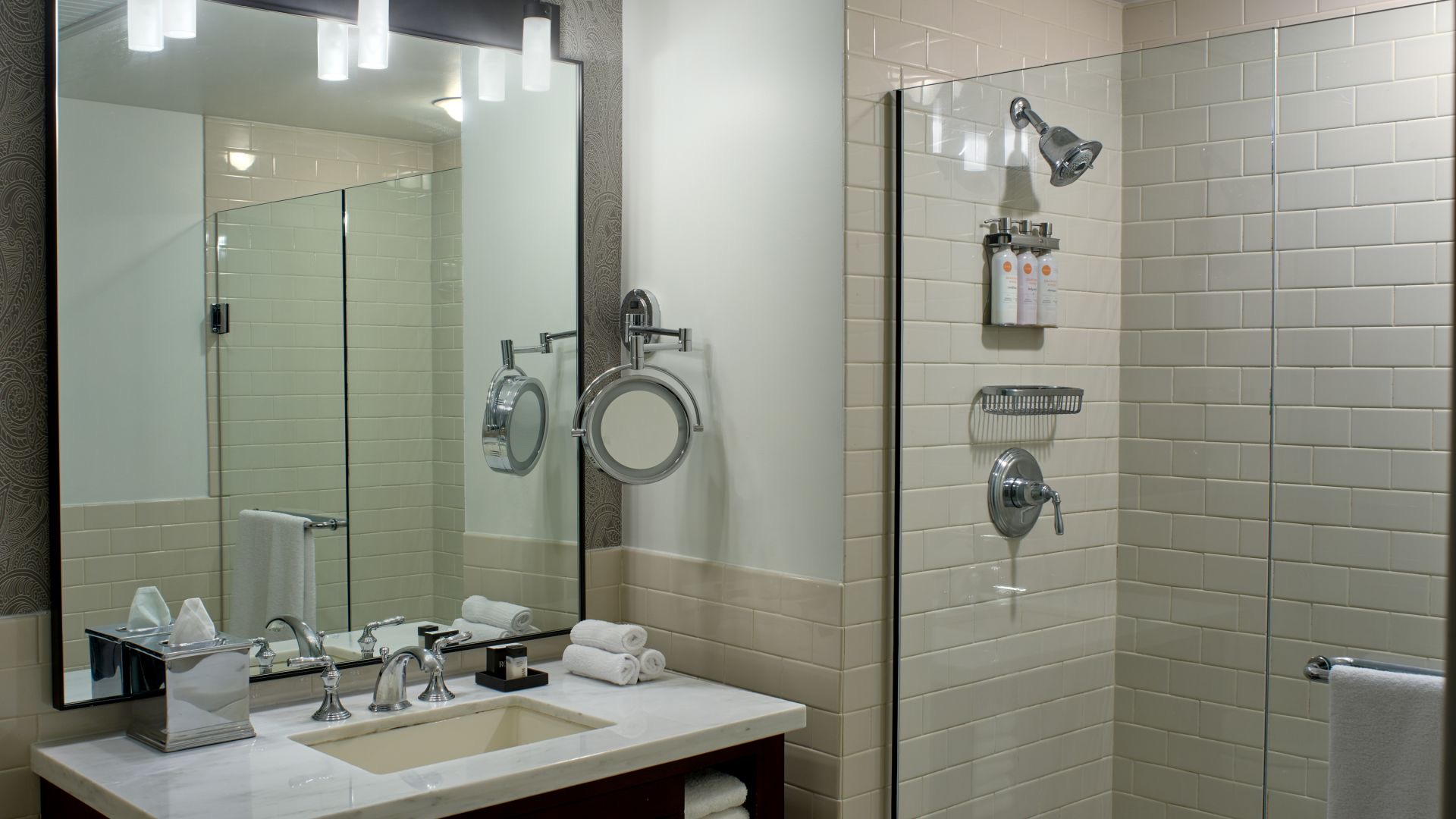 The bathroom features a walk-in shower