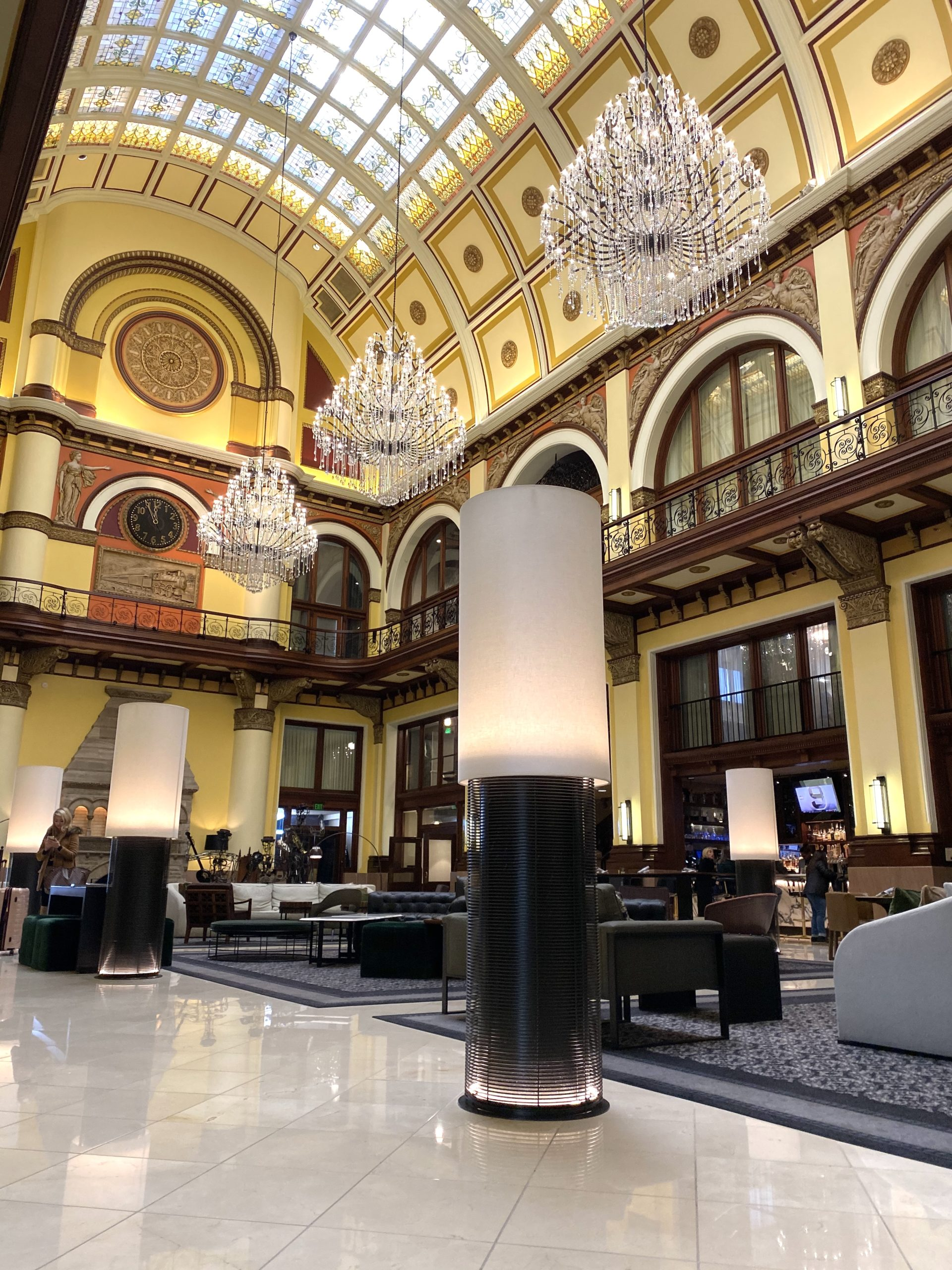 The stunning beauty of the Union Station Hotel lobby extends all the way to stained-glass ceilings.