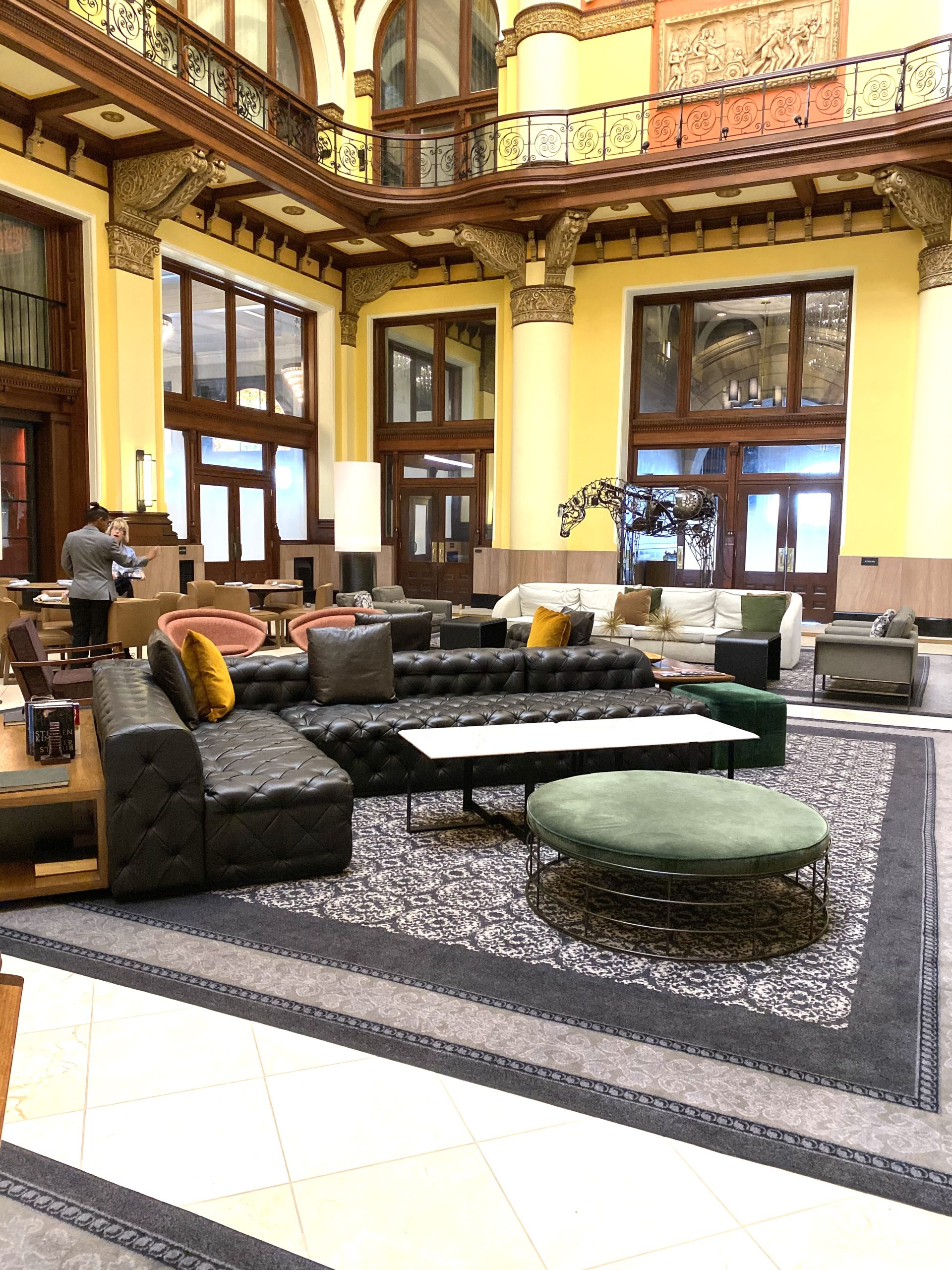 The modern & luxurious furniture is such an inviting twist on the old-school charm of the lobby.